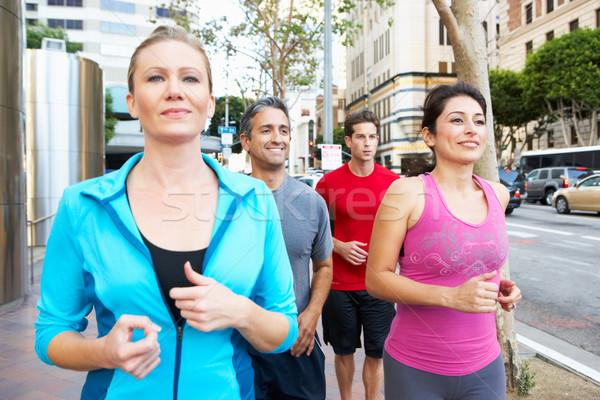 Csoport futók városi utca nő férfiak Stock fotó © monkey_business