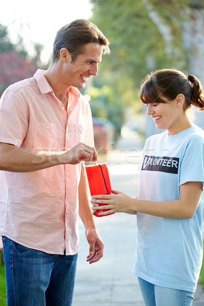 Charity Worker Collecting From Man In Street Stock photo © monkey_business