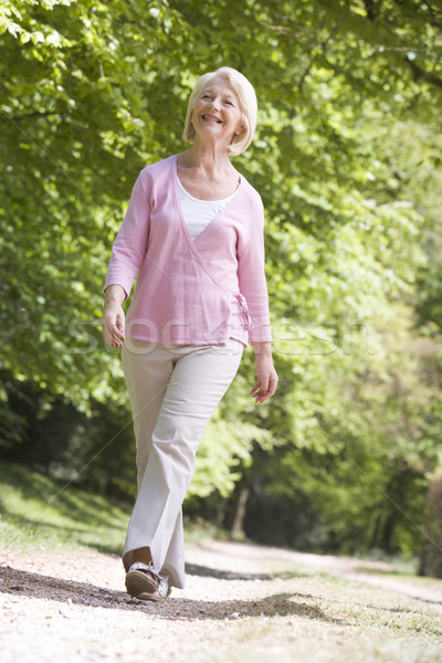 Woman walking outdoors smiling Stock photo © monkey_business