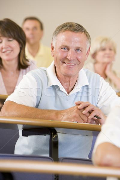 Senior man listening to a university lecture Stock photo © monkey_business