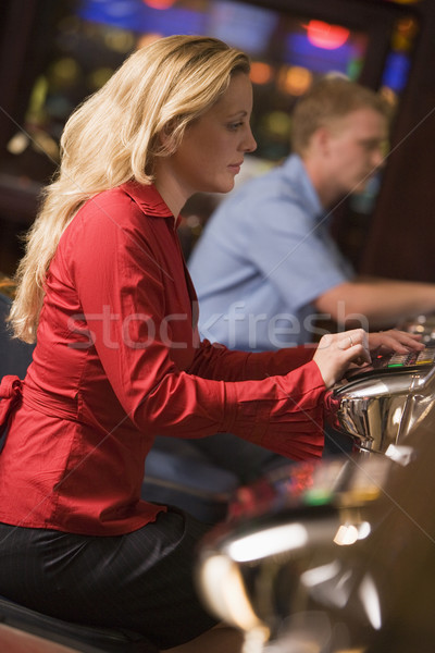 Woman sitting at slot machine in casino Stock photo © monkey_business