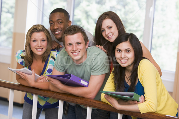 Group of college students leaning on banister Stock photo © monkey_business