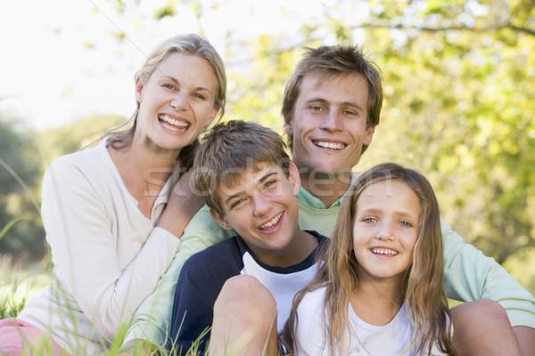 Famille séance extérieur souriant fille amour Photo stock © monkey_business