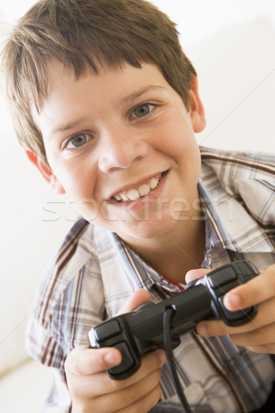 Young boy holding video game controller smiling Stock photo © monkey_business