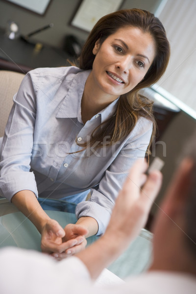Woman having meeting with doctor in IVF clinic Stock photo © monkey_business