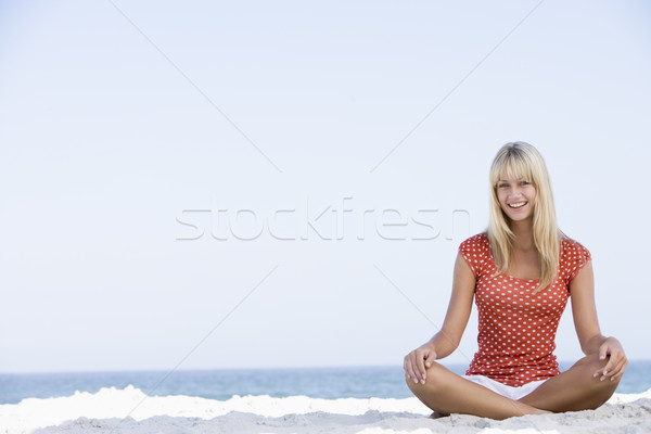 Young woman relaxing on beach Stock photo © monkey_business