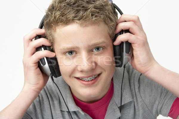 Portrait of Smiling Teenage Boy Listening to Music Stock photo © monkey_business