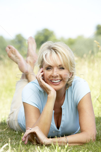 Portrait of mature woman relaxing in countryside Stock photo © monkey_business