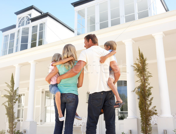 Young Family Standing Outside Dream Home Stock photo © monkey_business