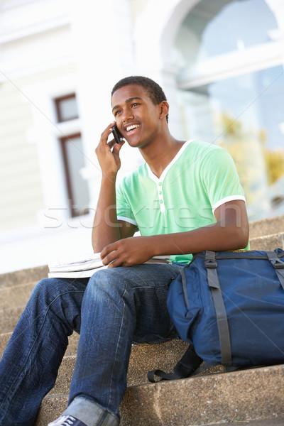 Férfi tini diák ül kívül főiskola Stock fotó © monkey_business
