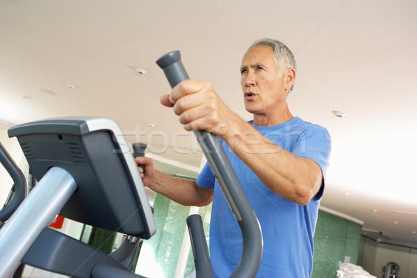 Senior Man On Cross Trainer In Gym Stock photo © monkey_business