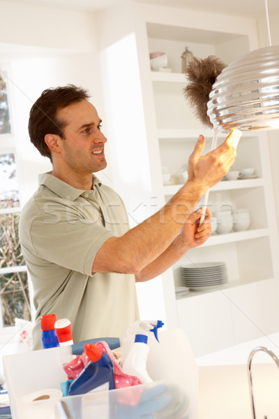 Man Cleaning Light Fitting With Feather Duster Stock photo © monkey_business