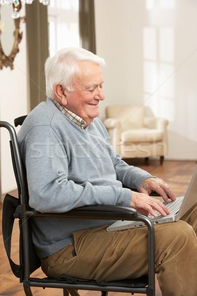Disabled Senior Man Sitting In Wheelchair Using Laptop Stock photo © monkey_business