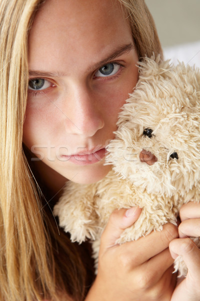 Unhappy teenage girl with cuddly toy Stock photo © monkey_business