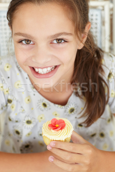 Young girl with cupcake Stock photo © monkey_business
