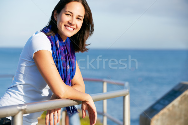 Hispanic Woman Looking Over Railing At Sea Stock photo © monkey_business