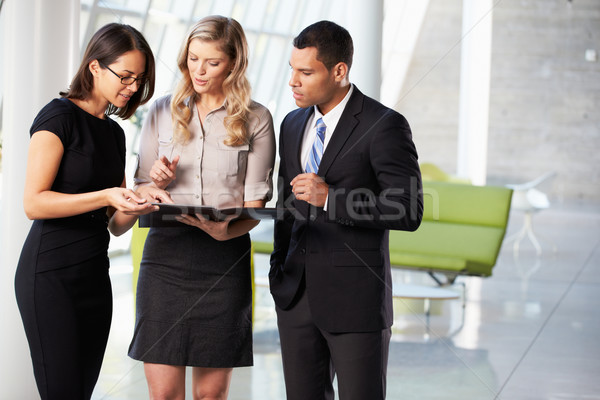 Businesspeople Having Informal Meeting In Modern Office Stock photo © monkey_business