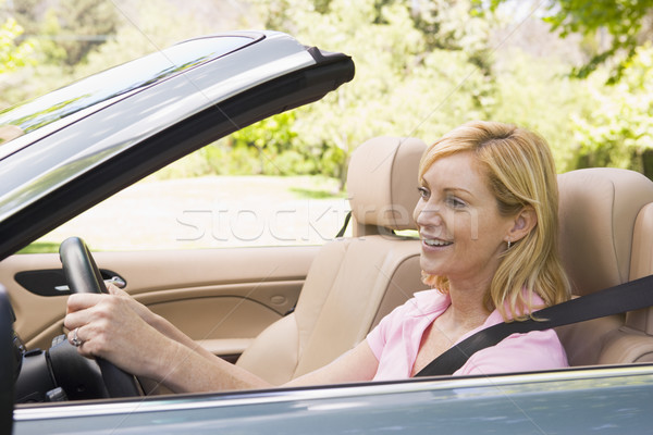 Woman in convertible car smiling Stock photo © monkey_business