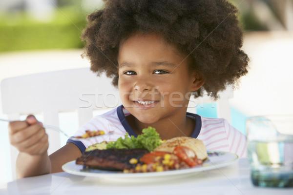 Młoda dziewczyna jadalnia fresk ogród pić tablicy Zdjęcia stock © monkey_business