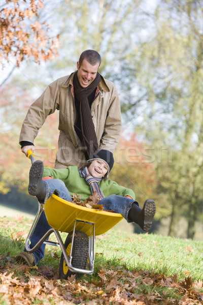 Father giving son ride in wheelbarrow Stock photo © monkey_business