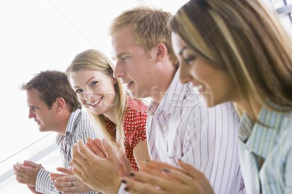 Quatre gens d'affaires souriant affaires Photo stock © monkey_business