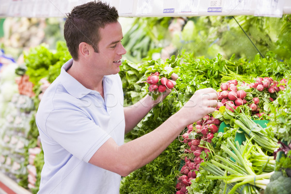 Man shopping in produce department Stock photo © monkey_business