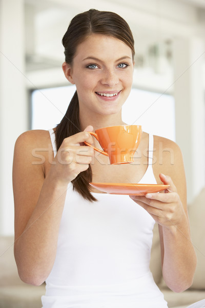 Young Woman Drinking Out Of An Orange Cup Stock photo © monkey_business