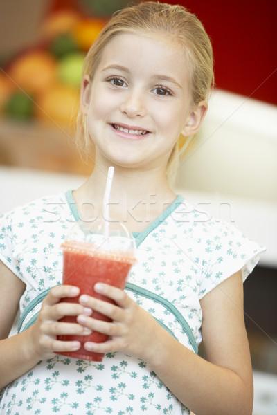Fiatal lány iszik bogyó smoothie boldog ital Stock fotó © monkey_business