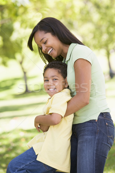 Stock photo: Woman and young boy outdoors embracing and smiling