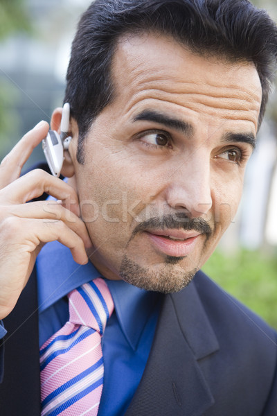 Businessman using bluetooth earpiece Stock photo © monkey_business
