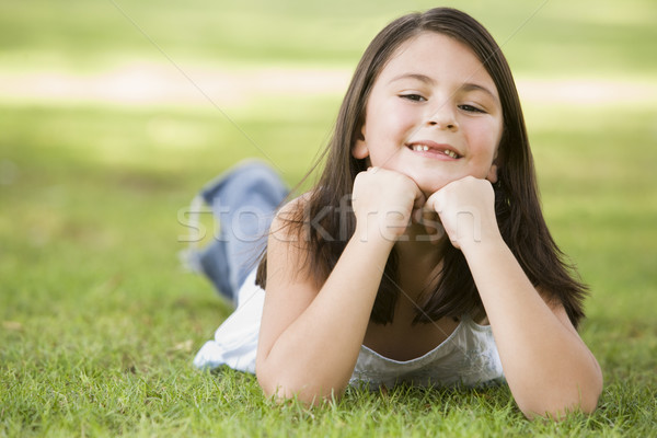 Stock photo: Girl relaxing in park