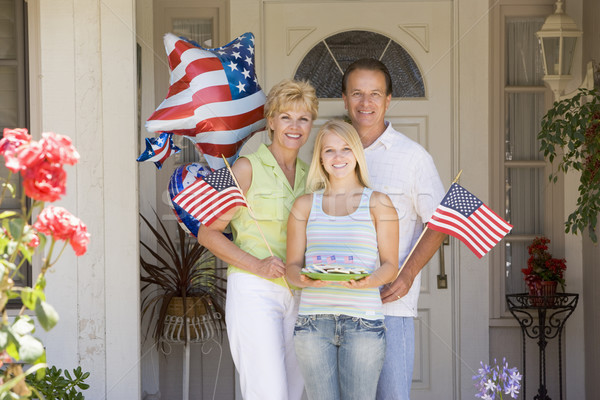 Family at front door on fourth of July with flags and cookies sm Stock photo © monkey_business