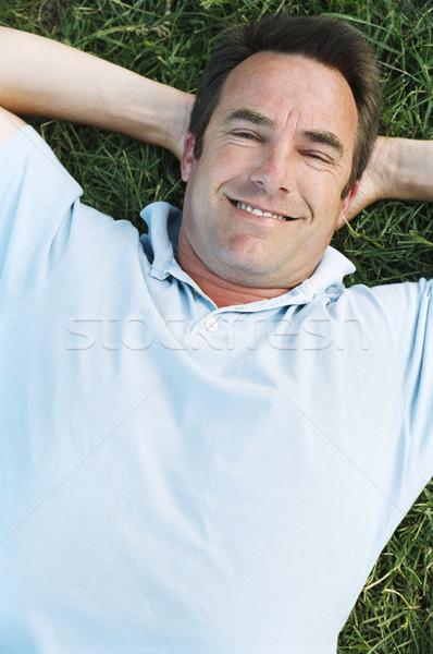 Homem ao ar livre sorridente grama feliz verão Foto stock © monkey_business