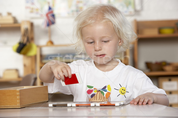 Adult Helping Young Children at Montessori/Pre-School Stock photo © monkey_business