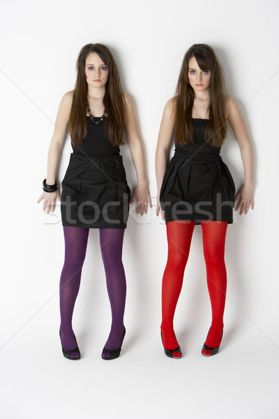 Studio Portrait Of Fashionably Dressed Twin Teenage Girls Stock photo © monkey_business