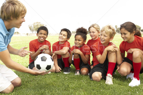 Young Boys And Girls In Football Team  With Coach Stock photo © monkey_business