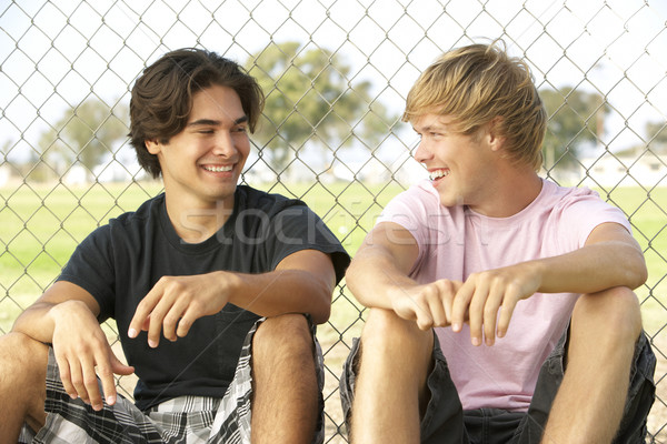 Group Of Teenagers Sitting In Playground Stock photo © monkey_business