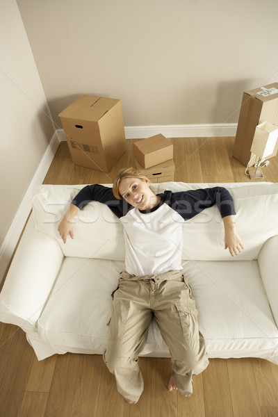 Overhead View Of Young Woman Moving Into New Home Stock photo © monkey_business