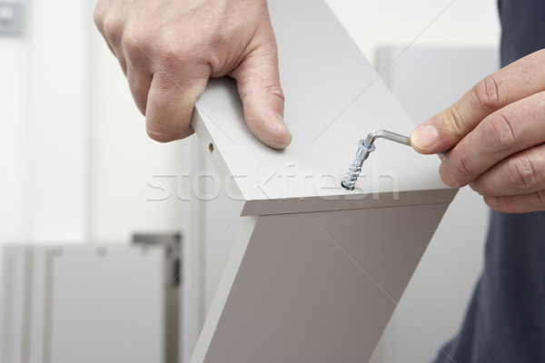 Close Up Of Man Assembling Flat Pack Furniture Stock photo © monkey_business
