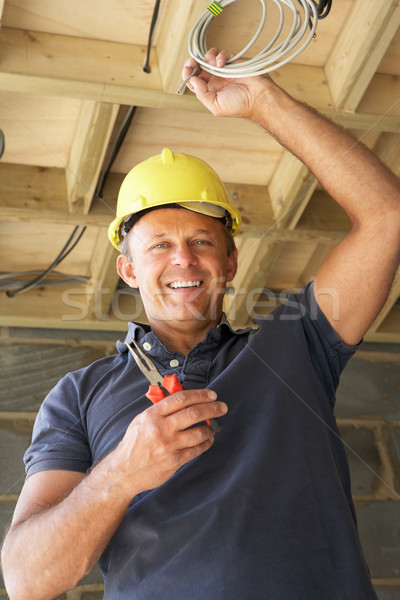 Electrician Working On Wiring In New Home Stock photo © monkey_business