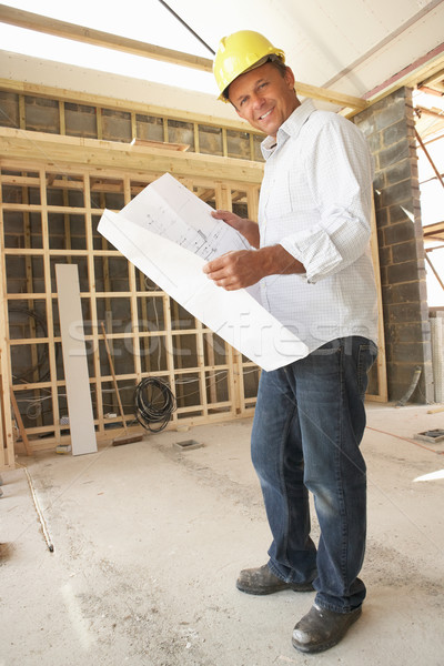 Stock photo: Architect With Plans In New Home