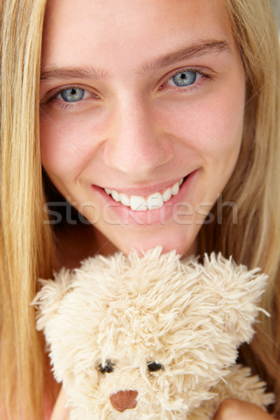 Close up teenage girl with cuddly toy Stock photo © monkey_business