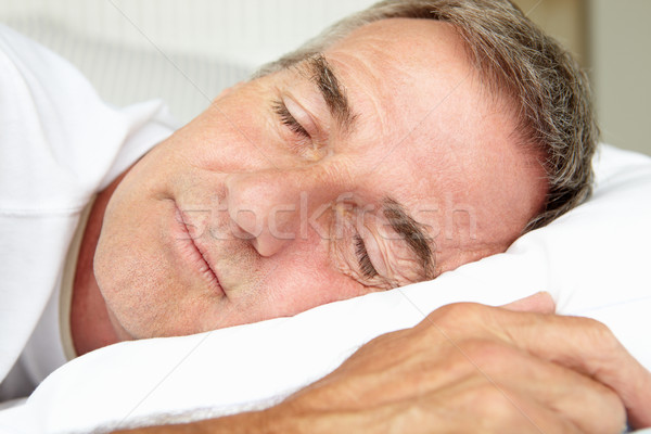 Head and shoulders mid age man sleeping Stock photo © monkey_business