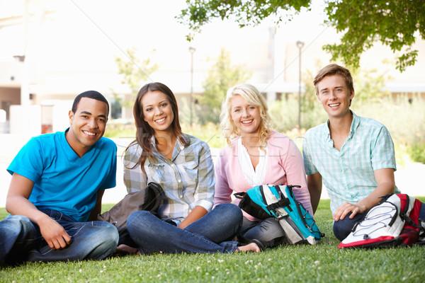 Estudante grupo ao ar livre grama mulheres amigos Foto stock © monkey_business