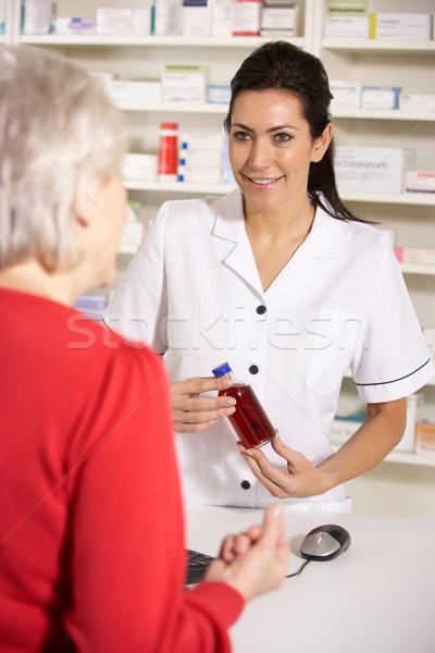 American pharmacist dispensing to senior woman Stock photo © monkey_business