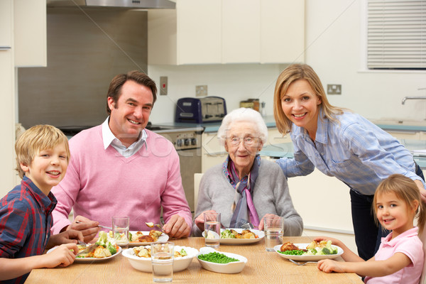 Multi-generation family sharing meal together Stock photo © monkey_business