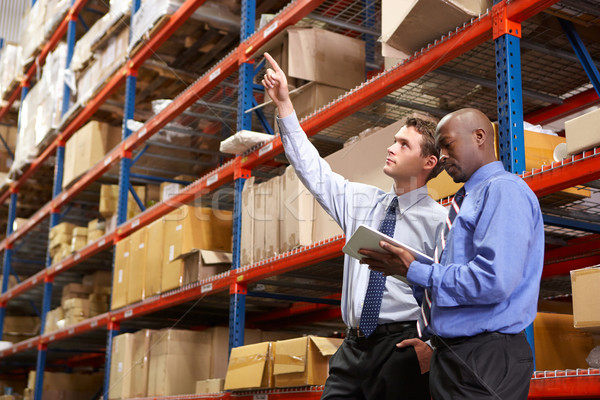 Two Businessmen With Digital Tablet In Warehouse Stock photo © monkey_business