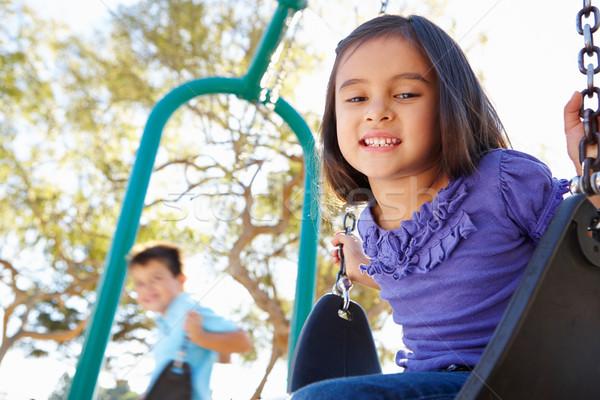 мальчика девушки играет Swing парка ребенка Сток-фото © monkey_business