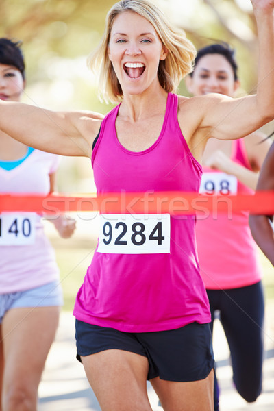 Female Runner Winning Marathon Stock photo © monkey_business