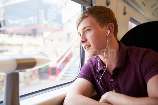 Moço ouvir música trem jornada homem homens Foto stock © monkey_business